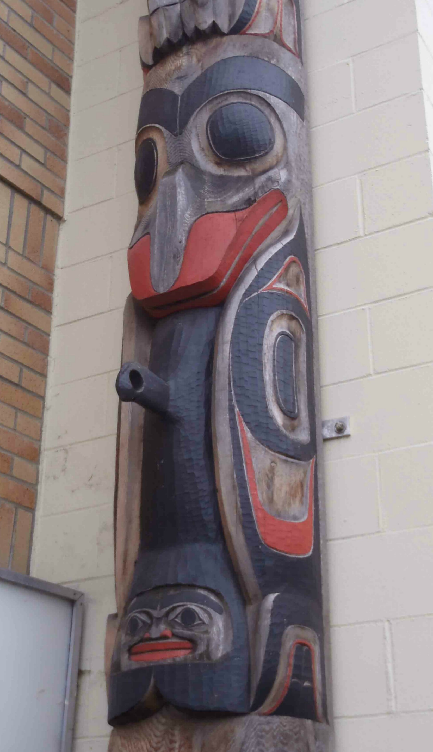 Bringing Light To The World totem pole, Killer Whale figure, Station Street, Duncan, B.C.