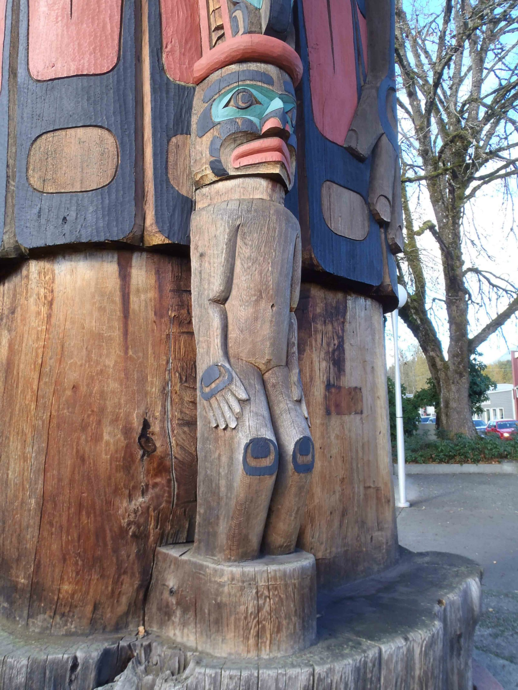 Cedar Man Walking Out of the Log, totem pole, Duncan, B.C. Man figure