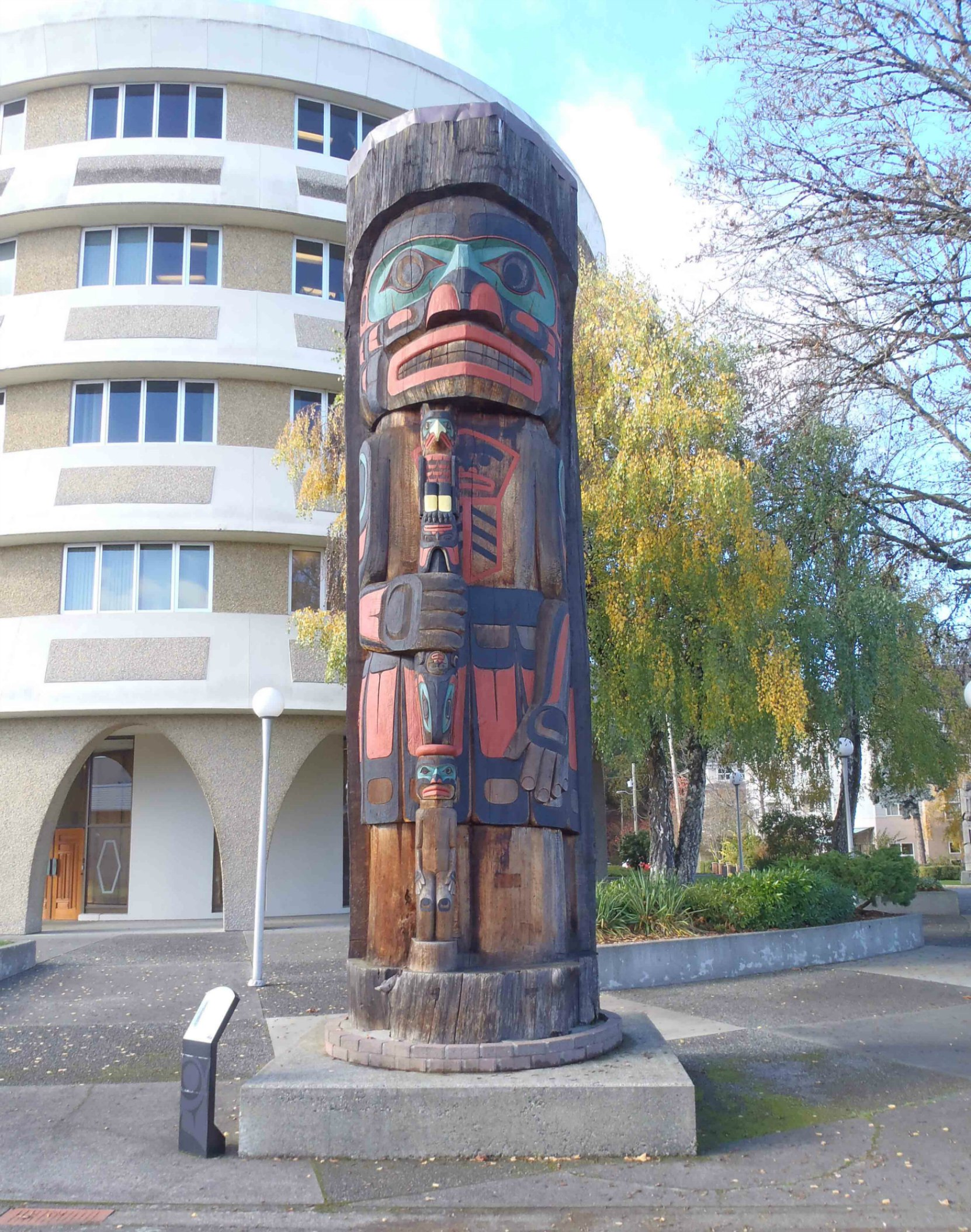 Cedar Man Walking Out of the Log, totem pole, Duncan, B.C.