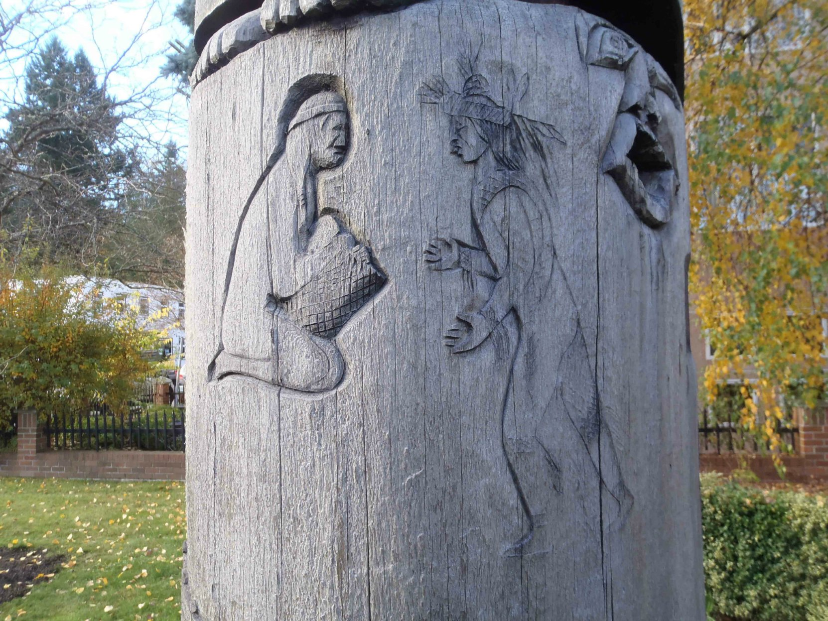 Carving detail on Cedar Woman and Man totem pole, Duncan, B.C.
