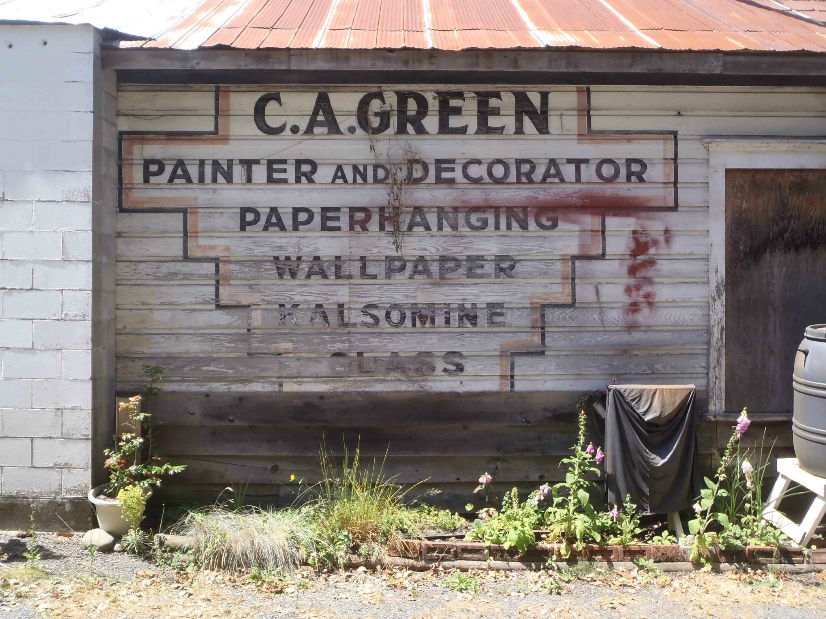 Sign for Claude Green's paint contracting business, circa 1940, is still visible on 161 Kenneth Street