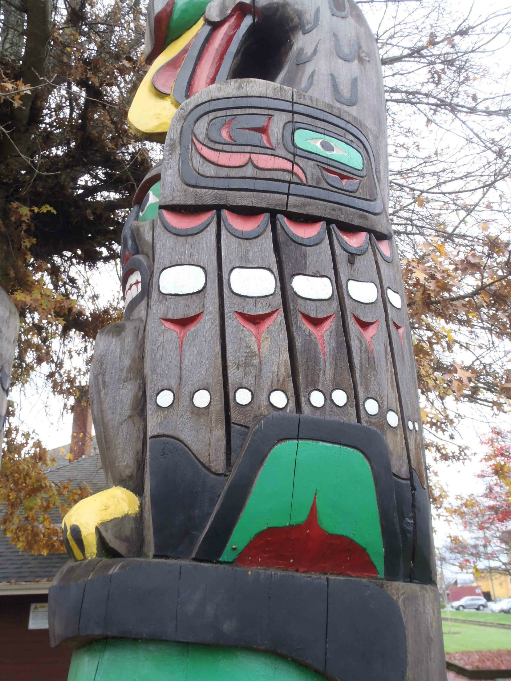 Friendship Pole, Eagle figure, wing detail, Charles Hoey Park, Duncan, B.C.