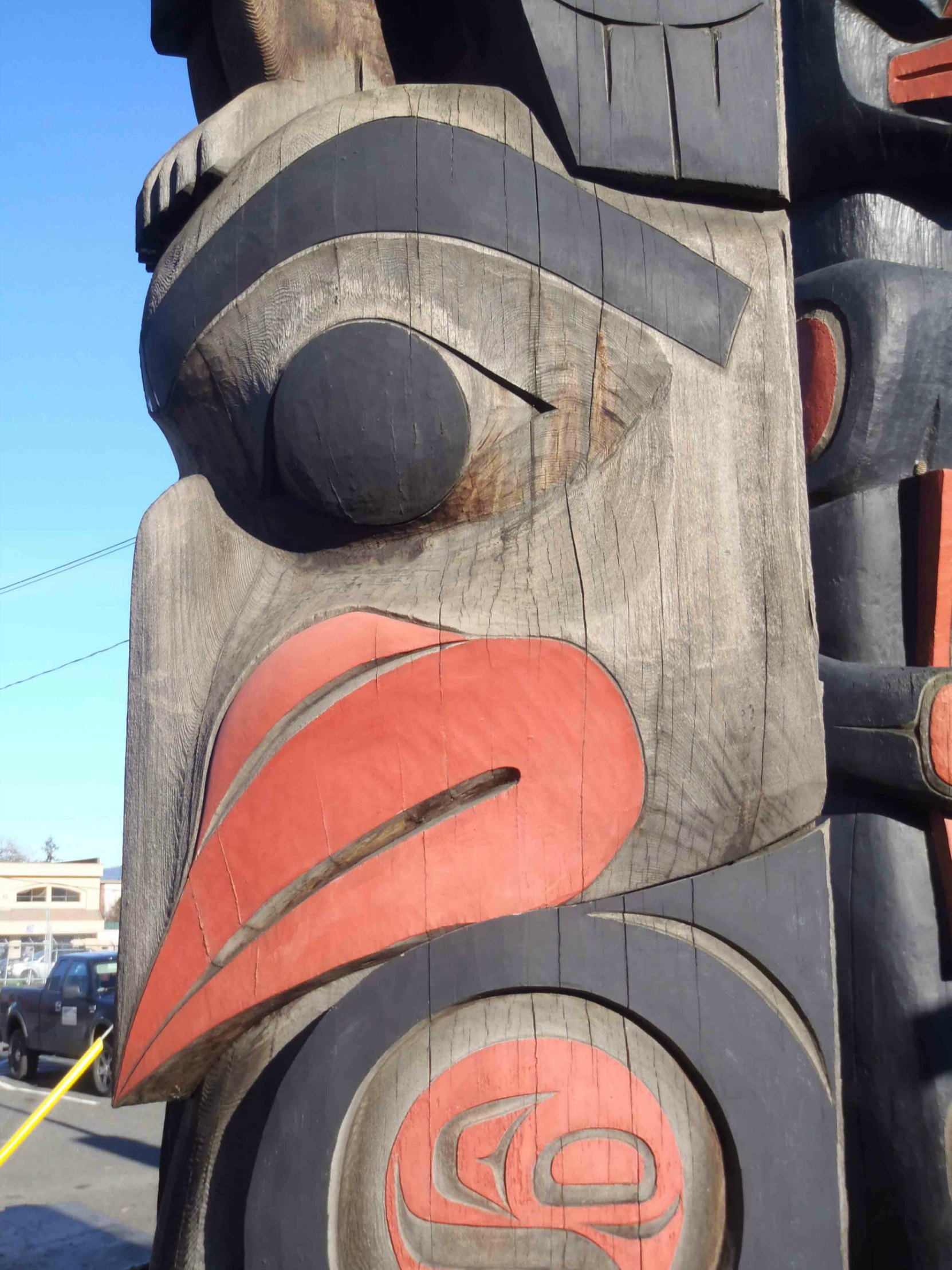 The Guardians pole, Eagle figure, face detail, Government Street at Kenneth Street, Duncan, B.C.