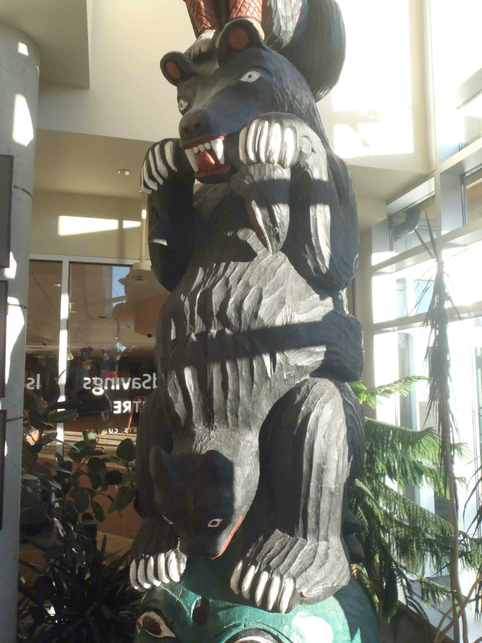 Provincial Route of the Totems Salish Bear pole, Salish Bear figure, displayed in Vancouver Island Public Library, Cowichan Branch.