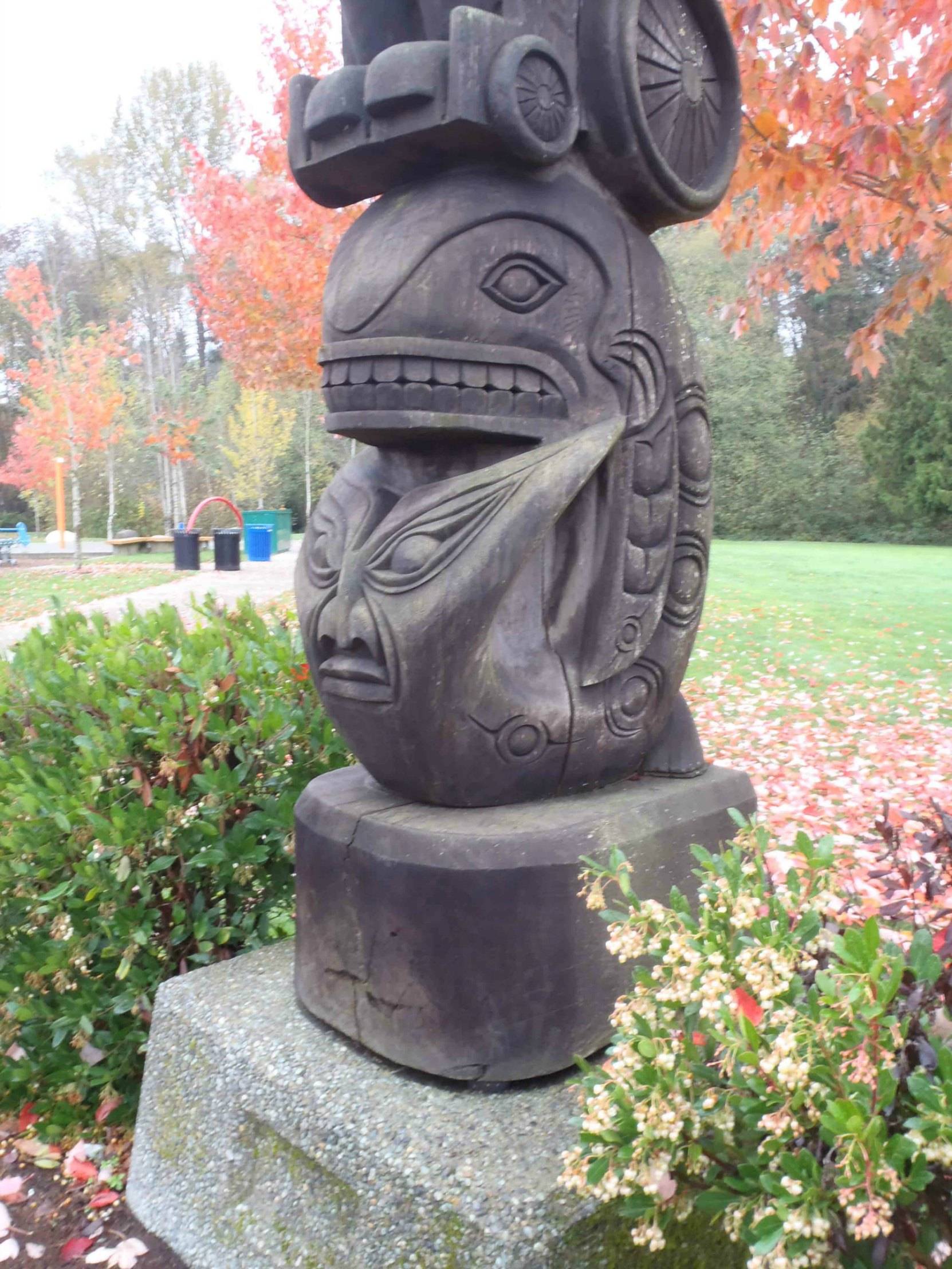 Rick Hansen Man In Motion totem pole, Centennial Park, Duncan, B.C., Killer Whale and Wolf figures