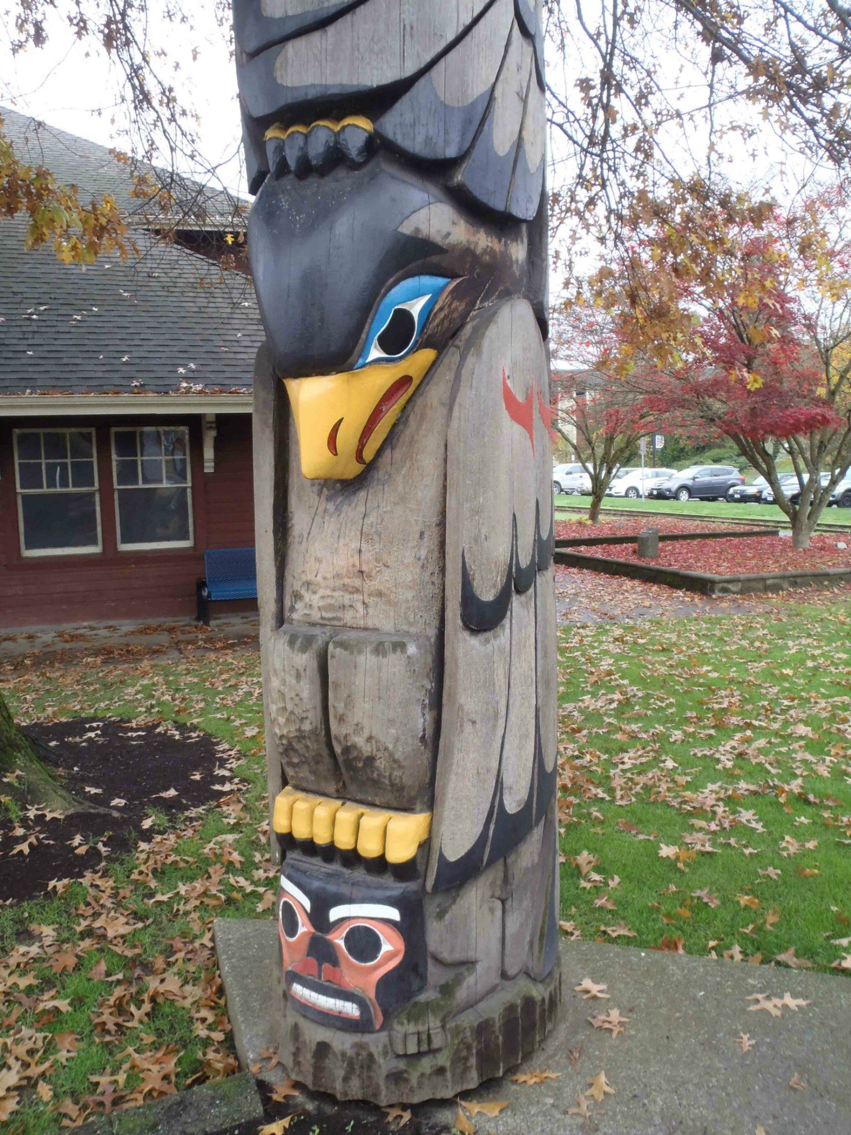 Transformation In Life totem pole, Bald Eagle and Man figures, Canada Avenue, Duncan, B.C.