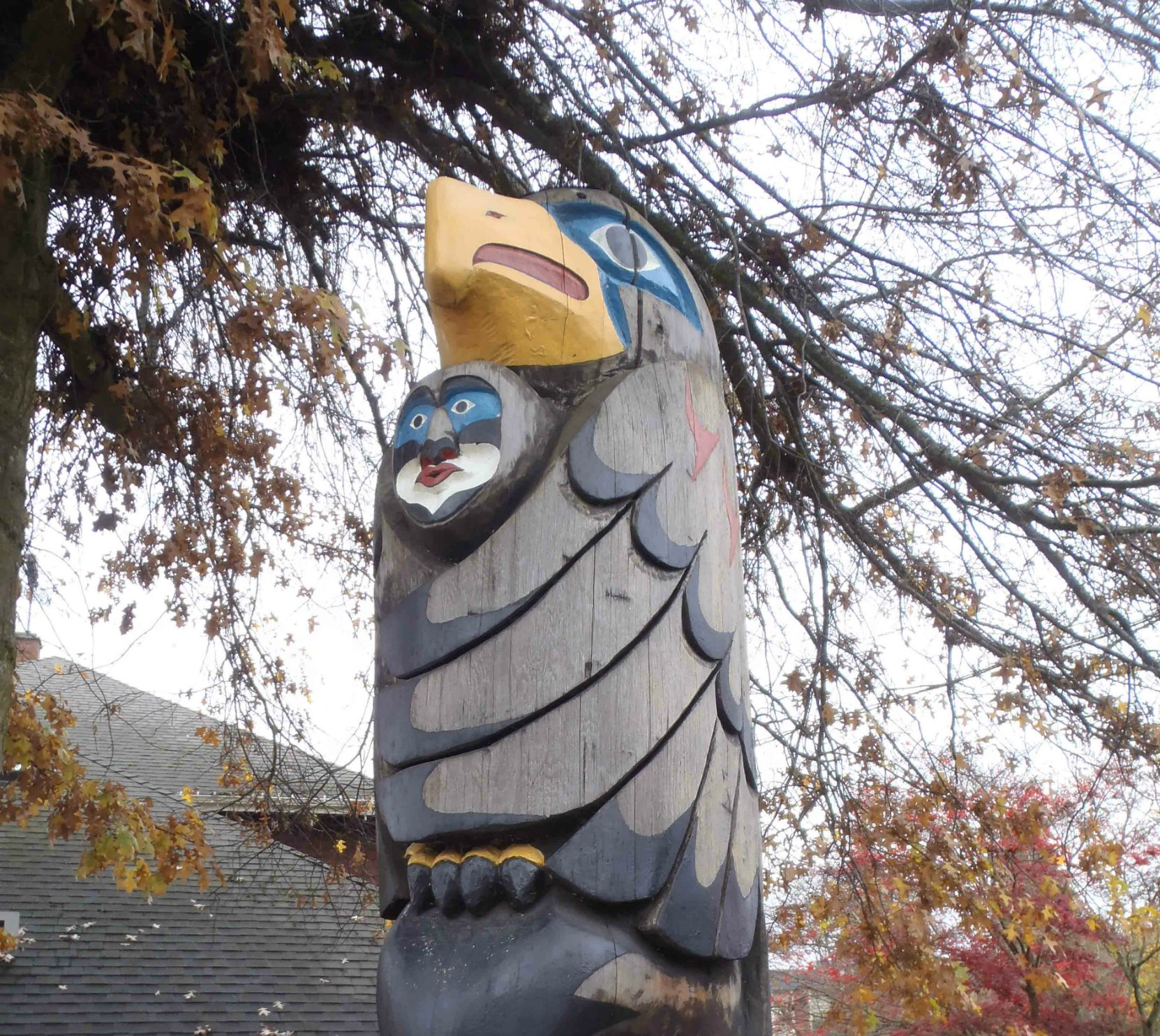 Transformation In Life totem pole, Eagle Guardian figure, Canada Avenue, Duncan, B.C.