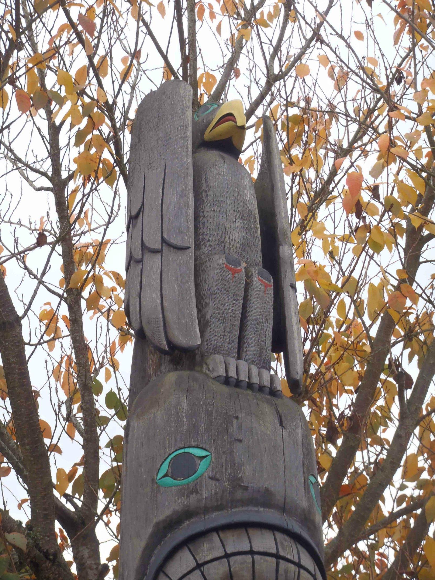 Tzinquaw Story totem pole, Thunderbird figure, Kenneth Street, Duncan, B.C.
