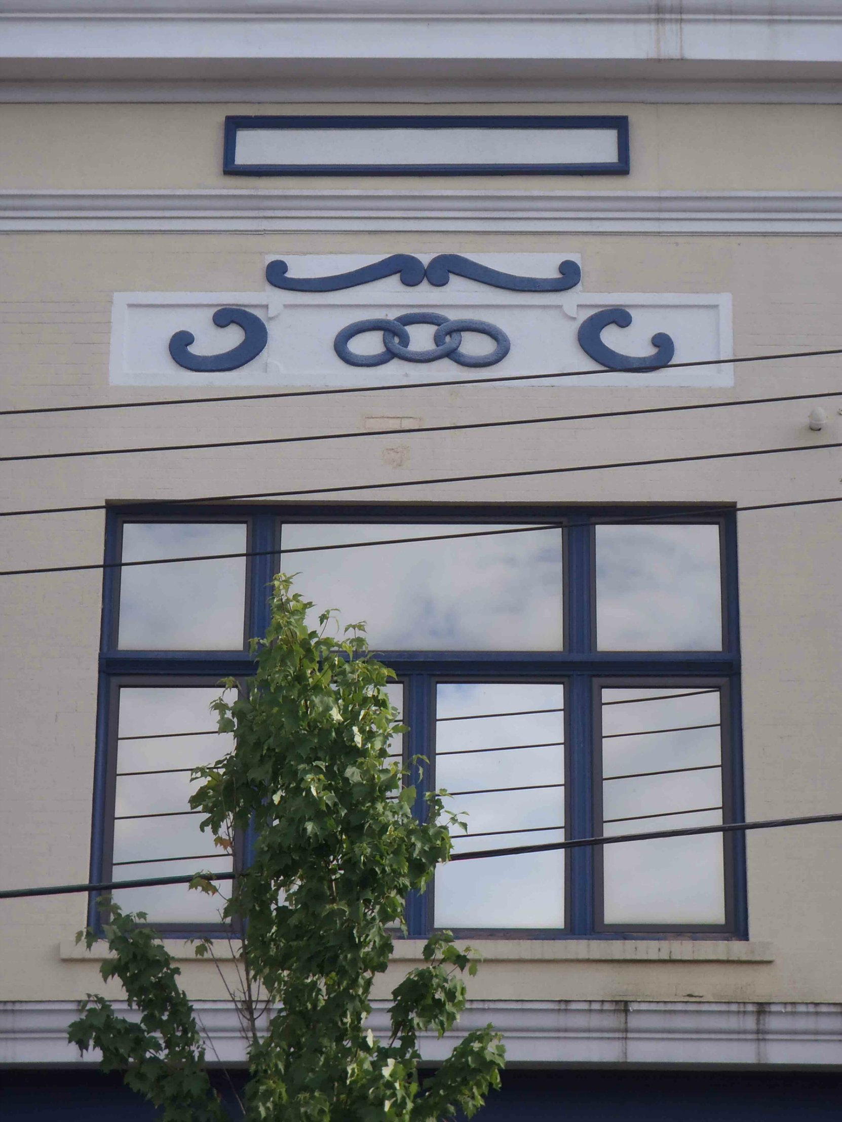 Independent Order of Odd Fellows (I.O.O.F) symbol on Whitome Building exterior