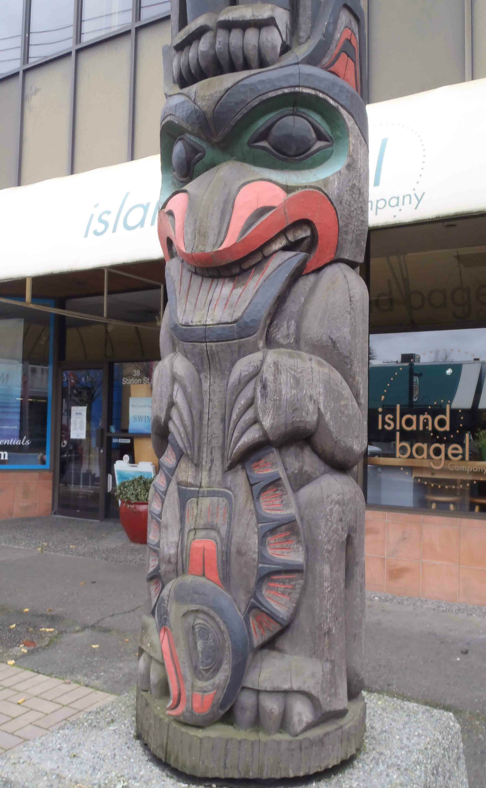 Wind Spirit totem pole, Bear and Halibut figures, Station Street, Duncan, B.C.
