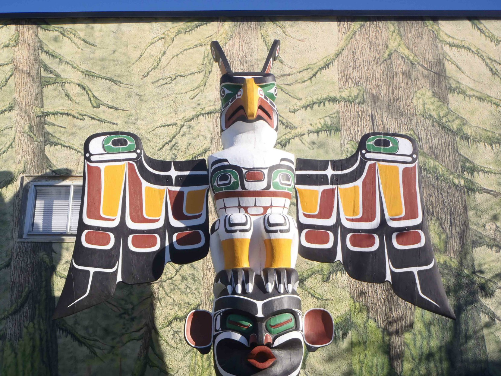 Thunderbird and Dzunuk'wa totem pole,Thunderbird figure, Station Street at Craig Street, Duncan, B.C.