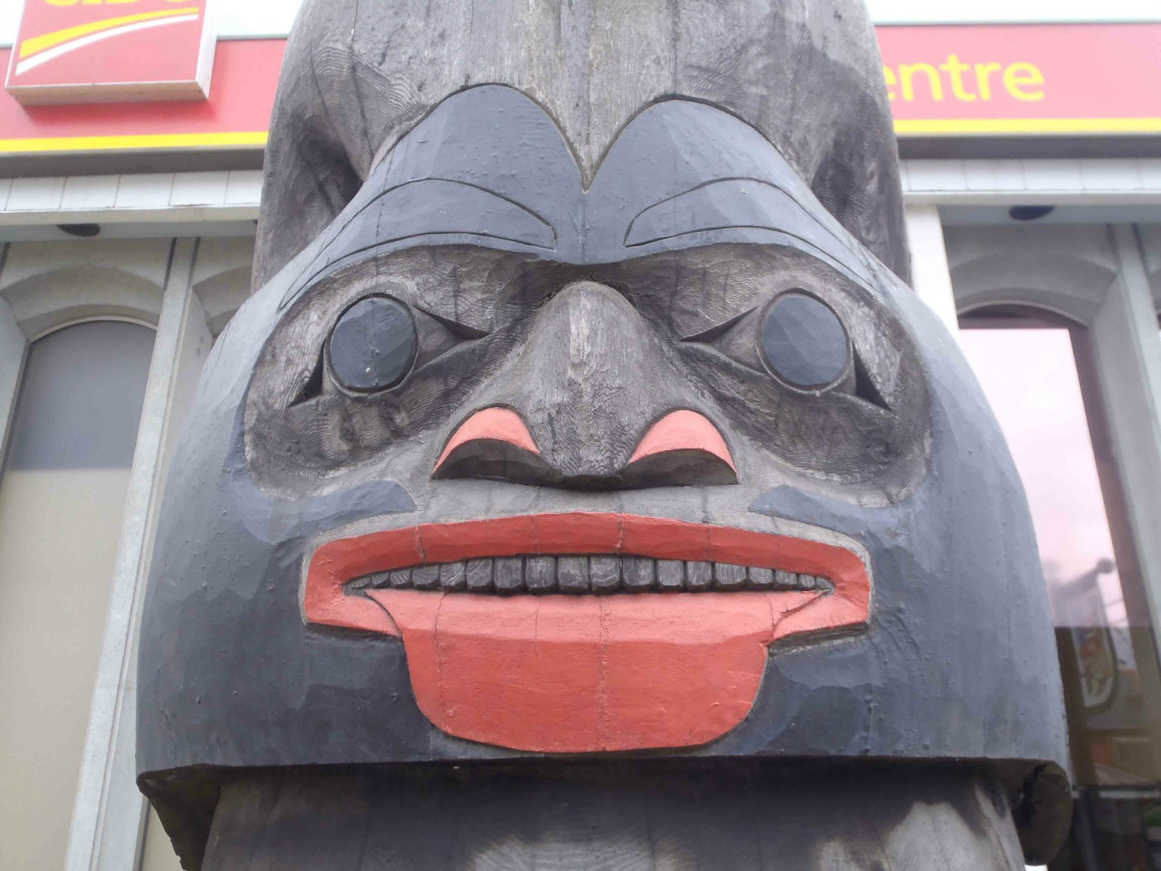 Harvest Time totem pole, North Wind figure, Station Street and Craig Street, Duncan, B.C.