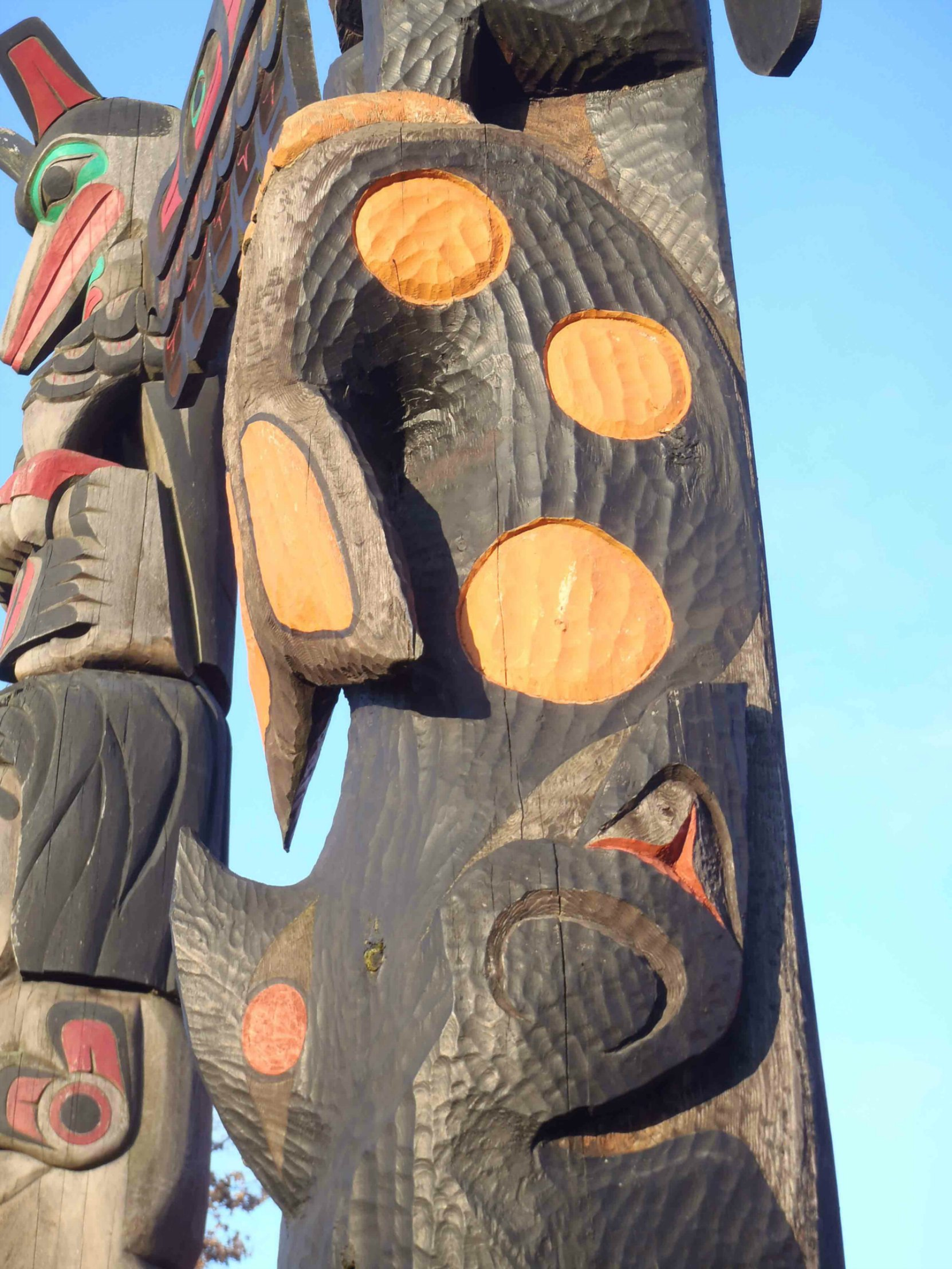 Pole of Wealth, Killer Whale figure detail. Canada Avenue at Kenneth Street