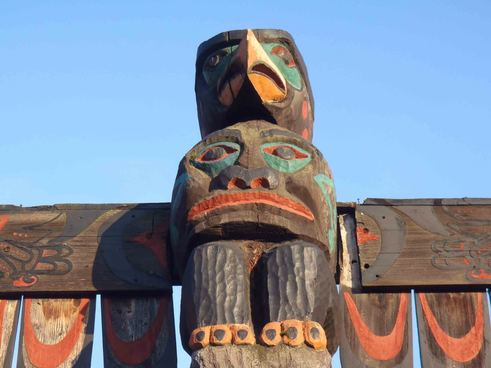 Pole of Wealth, Thunderbird and Spirit figures. Canada Avenue at Kenneth Street