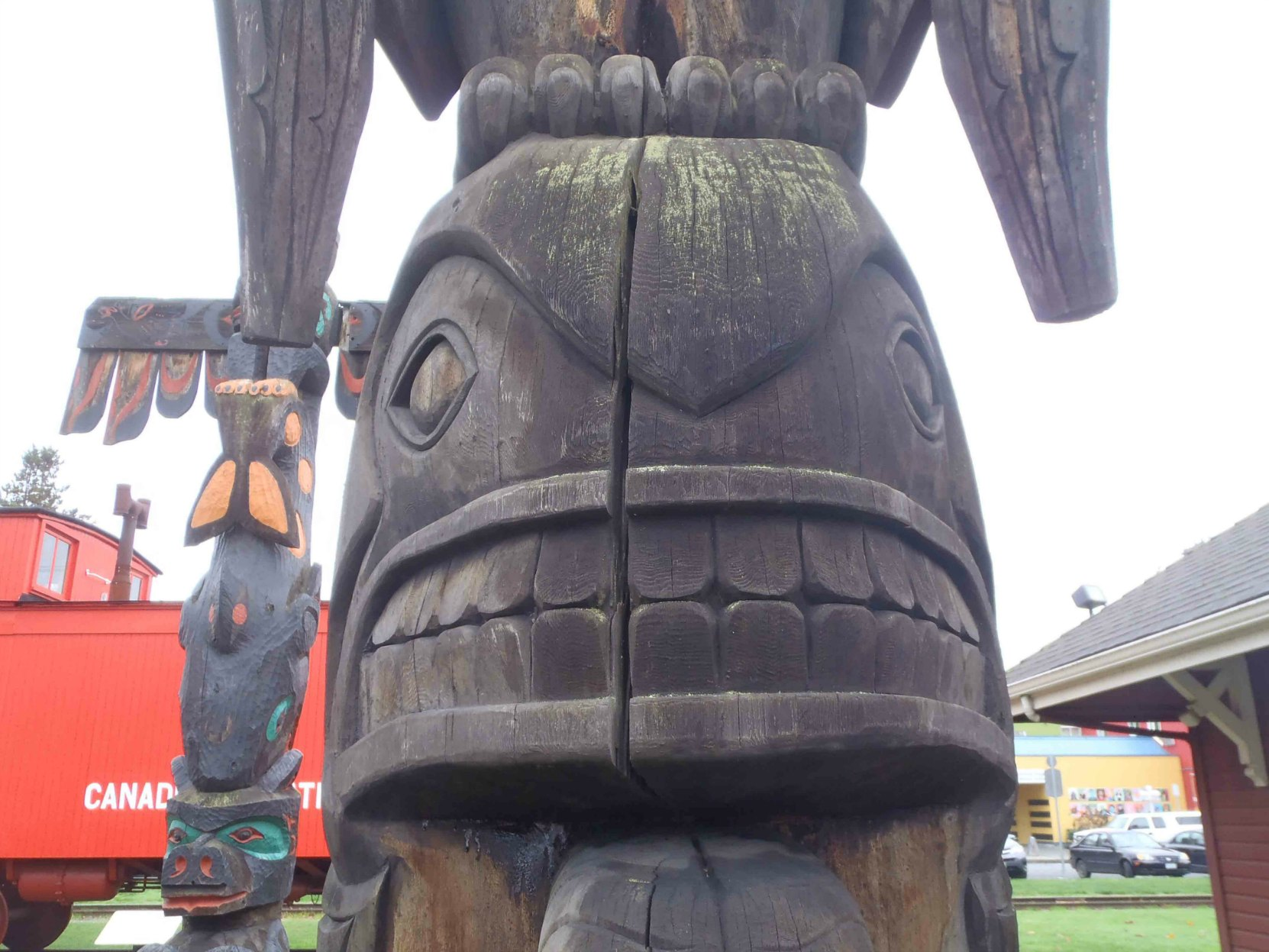 Transformation totem pole, Killer Whale figure detail - Canada Avenue, Duncan