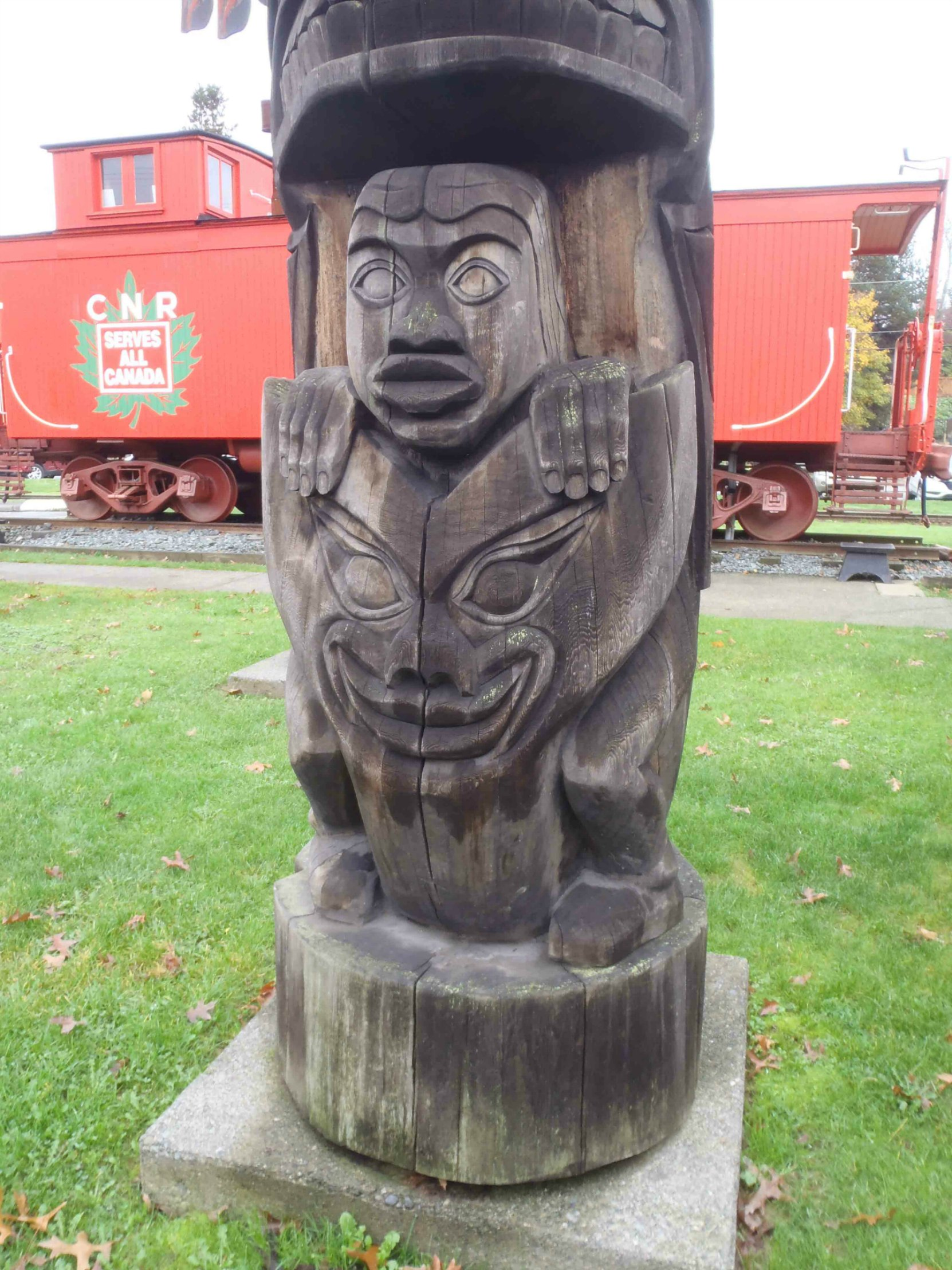 Transformation totem pole - Man and Wolf figure detail - Canada Avenue, Duncan