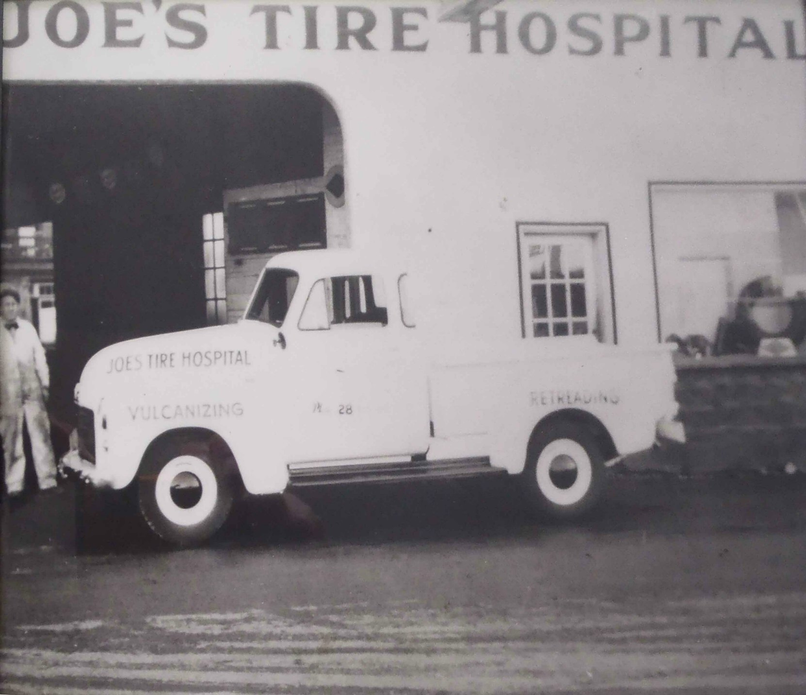 Joe's Tire Hospital founder Joe Drennan at Joe's Tire Hospital, 176 Government Street, circa 1940.