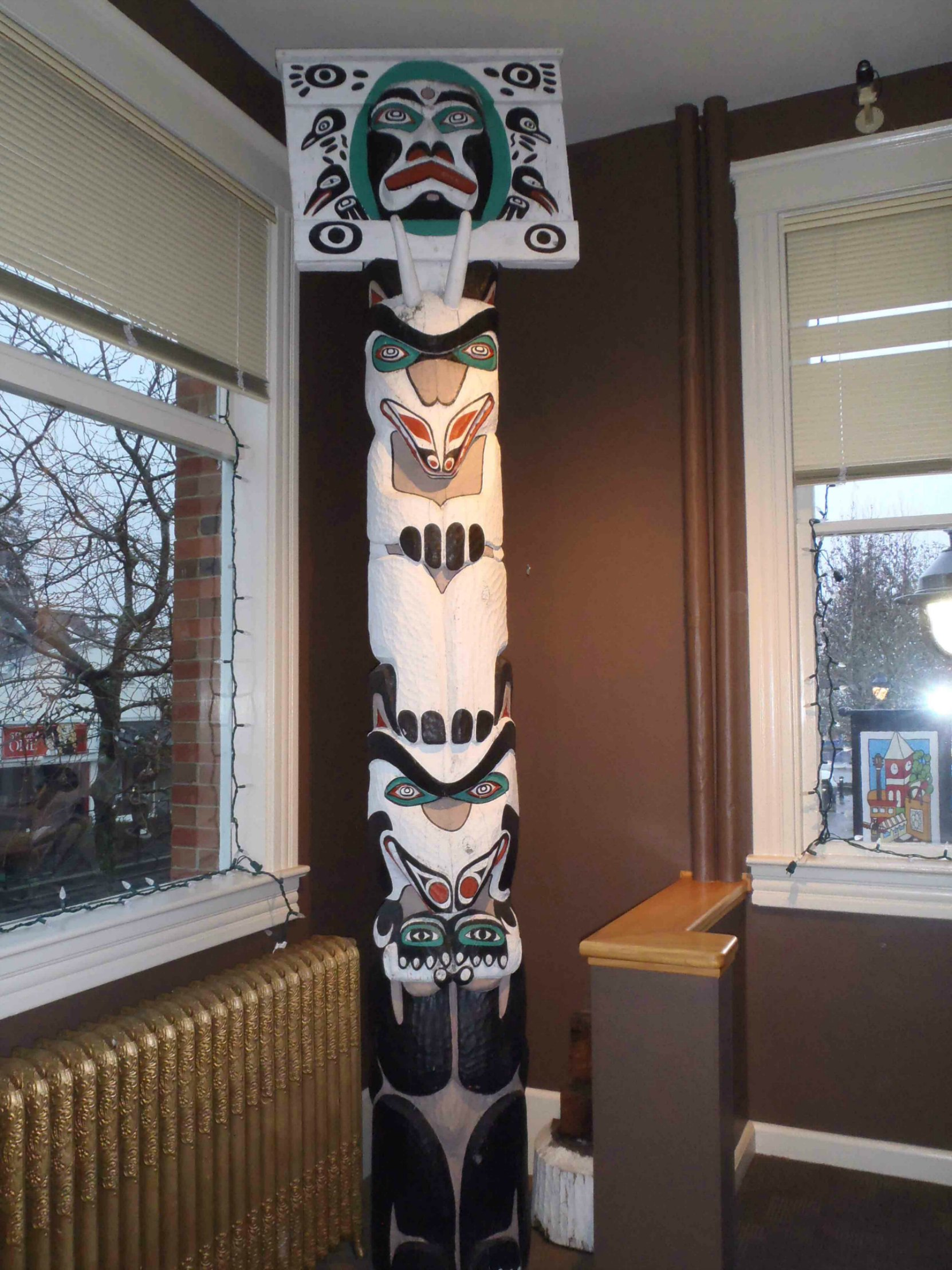 Mortuary Pole, carved by Simon Charlie, is displayed inside Duncan City Hall